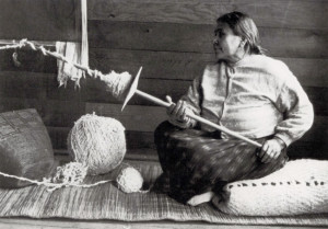 Woman spinning yarn at the Coast Salish village of Musqueam. Charles F. Newcombe, December 5, 1915. Direct duplicate negative. PN 83 – Royal BC Museum/BC Archives.