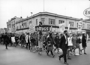 University of Victoria Alma Mater Society President Paul Williams leads a large group of students down Douglas Street protesting fees increase on 18 October 1965.